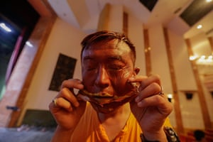 FTA: Jason Lee: Artist Liu Bolin removes a face mask after his latest project in Beijing
