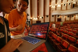 FTA: Jason Lee: Artist Liu Bolin and his assistant examine an image during Liu's latest pro