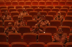 FTA: Jason Lee: Artist Liu Bolin (3rd row, right) sits with other participants