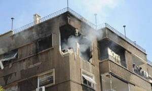 Apartment block hit by mortar in central Damascus