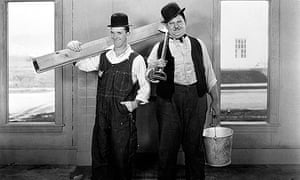 STAN LAUREL and OLIVER HARDY posing as builders STAN LAUREL, OLIVER HARDY STAN LAUREL, OLIVER HARDY