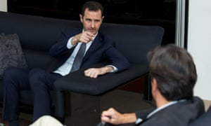 Syria's president Bashar al-Assad gestures during an interview with French daily Le Figaro in a picture  distributed by Syria's national news agency SANA.