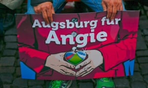 "A supporter holds a placard with the slogan ""Augsburg for Angie"" before the arrival of German Chancellor Angela Merkel and Bavarian state Premier Horst Seehofer during a Christian Democratic Union election campaign meeting in Augsburg September 19, 2013."