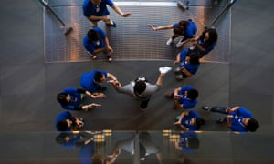 Employees cheer a customer after he bought new iPhone at an Apple store in Beijing, China. Apple have released the iPhone 5S and 5C models.