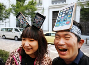 Tech heads: Yui Kashima and Nobuhiko Matsuda wait to purchase an Apple's new iPhone outside a store in Tokyo, Japan.