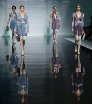 Models wear creations for Emporio Armani women's Spring-Summer 2014 collection, part of the Milan Fashion Week in Italy.