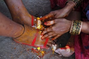 "In Allahabad an Indian Hindu couple from Andhra Pradesh state are pictured during ""Veni Dhan,"" a ritual where couples pray that they be reborn as husband and wife for seven lives."