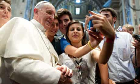 Pope Francis poses with youths in Saint Peter's Basilica at the Vatican