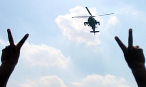An helicopter flying over the funeral procession of the Giza Police General Nabil Farrag in Cairo. General Nabil Farrag was killed after unidentified militants opened fire on security forces deployed in the town of Kerdasa.