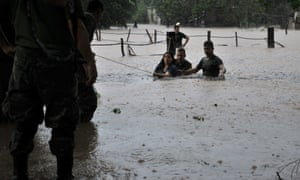 People being evacuated due to the flooding in Caimanero, Culiacan, Mexico. Hurricane Manuel was downgraded to a tropical storm but continued to dump heavy rain and rake north-western Mexico with powerful winds.