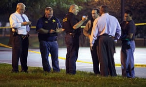 Officials convene near the scene of the Cornell Square Park shooting