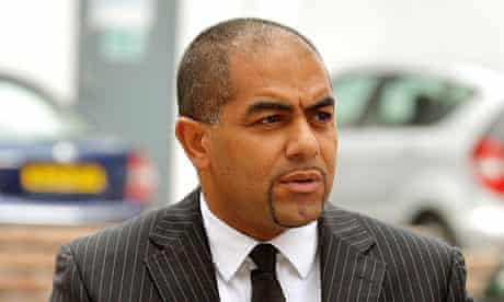 PC Rohan Scarlett, who assaulted Andrew Uba as he put him in a police van in February.