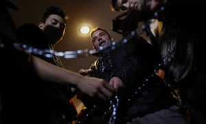 Members of the Victims' Mortgage Platform (PAH) tie each other with chains to prevent an eviction El Jaidi stopped paying rent after losing his job and had been unemployed for 14 month without getting any state benefits.