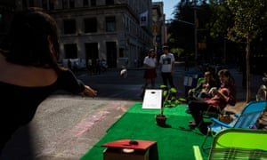 "Jessie Baker plays the game ""Corn Hole"" while paricipating in Park(ing) Day - where participants transform ordinary parking spaces into miniature public parks to bring attention to the environment and our reliance on cars."