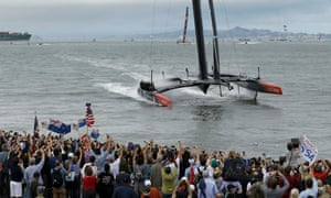 Fans cheer as Oracle Team USA approaches the finish line during the re-sail of the 13th race of the America's Cup sailing event against Emirates Team New Zealand in San Francisco.