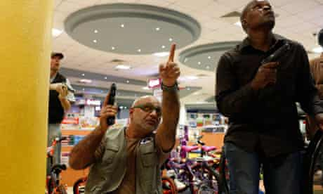 Security officers secure an area inside Westgate Shopping Centre in Nairobi