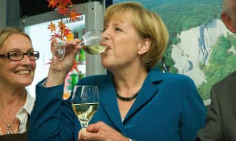 Angela Merkel drinks wine