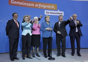Chancellor Angela Merkel celebrates on stage at the headquarters of her Christian Democratic Union (CDU) party after the German general elections on September 22, 2013 in Berlin, Germany.