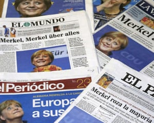 Front pages of Spanish newspapers are photographed in Madrid, Spain, on 23 September 2013, showing headlines and photos of German Chancellor Angela Merkel reacting to her victory in the German general elections.