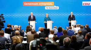 German Chancellor and leader of the Christian Democratic Union ( CDU) Angela Merkel addresses a news conference with Hesse's Prime Minister Volker Bouffier (L) and CDU press spokesperson Eva Woellner (R) after a CDU party board meeting in Berlin September 23, 2013, the day after the general election.