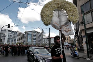 Ex-municipal police officers take part in a symbolic funeral for the closure of the Municipal Police, during a protest of municipal workers in central Athens, Greece, 23 September 2013.
