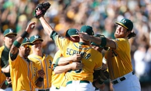 Oakland Athletics' Evan Scribner and teammates celebrate AL West championship
