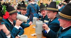 oktoberfest: Riflemen dressed in their traditional uniform clink their beer glasses