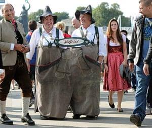 oktoberfest: Wilfried and Wilfried,  wear together a giant Lederhose