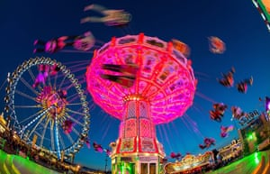 oktoberfest: A whirligig turns in front of the ferris wheel