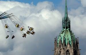 oktoberfest: People enjoy a swing ride in front of the St. Pauls church
