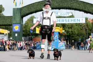 oktoberfest: A Bavarian dressed man with his sausage dogs