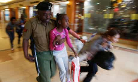 A soldier carries a child to safety in Nairobi