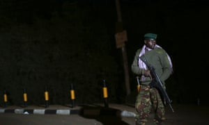 A Kenyan soldier holds his rifle near the Westgate shopping centre in Nairobi September 23, 2013.