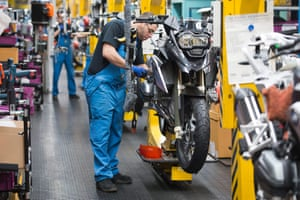 Employees assembling motorcycles at the BMW motorcycle factory in Berlin, Germany