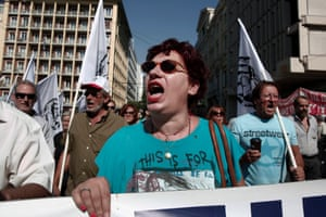 Protesters shout slogans as they march towards the parliament during the first day of a 48-hour strike by public sector workers in Athens September 24, 2013.