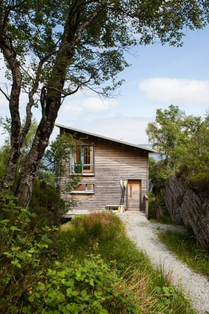 Homes - On The Rocks: wooden house surrounded by green landscape
