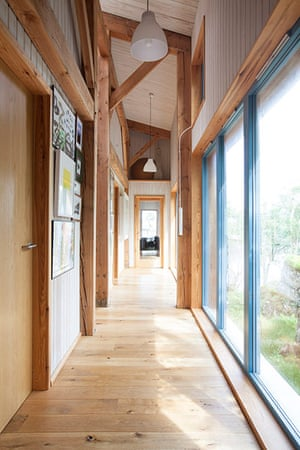 Homes - On The Rocks: hallway of wooden house with beams