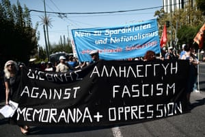 Demonstrators hold banners written in German, Greek and English in central Athens on September 24, 2013, during a protest against the coalition government of conservative Prime Minister and Greece's EU-IMF creditors