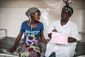 Making babies: A nurse makes notes after having examined a pregnant woman