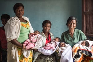 Making babies: Mothers and staff sit with newborn babies