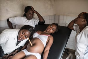Making babies: Nurses examine a pregnant woman at a health centre in Mbanza Ngungu