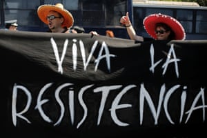 """Culture ministry workers wearing sombreros hold a banner reading, """"long live the resistance"""" during a rally by striking civil servants outside the Administrative Reform ministry, in central Athens, Tuesday, Sept. 24, 2013."""