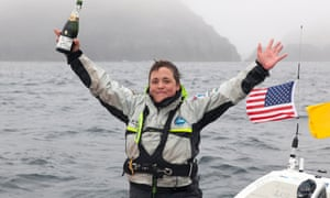 Sarah Outen celebrates after arriving in Adek, Alaska.