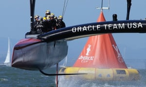 Oracle Team USA crosses the finish line during the 18th race of the America's Cup sailing event against Emirates Team New Zealand.