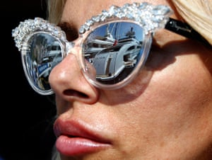 Yachts: Luxury boats are reflecting in a visitor's sunglasses