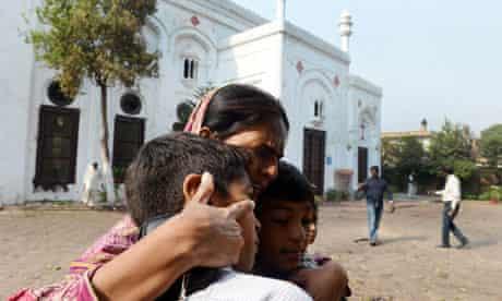 A Pakistani Christian woman embraces children