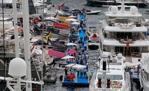 Yachts: Visitors walk between yachts