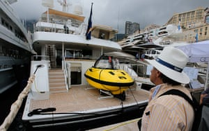 Yachts: A yacht with a submarine on the deck