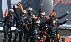 Oracle Team USA crew, including skipper Jimmy Spithill, second from left, and tactician Ben Ainslie, front centre, celebrate after winning  the America's Cup.