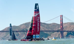 Emirates Team New Zealan and Oracle Team USA pass the Golden Gate Bridge while preparing for America's Cup race 16 on on September 23., 2013